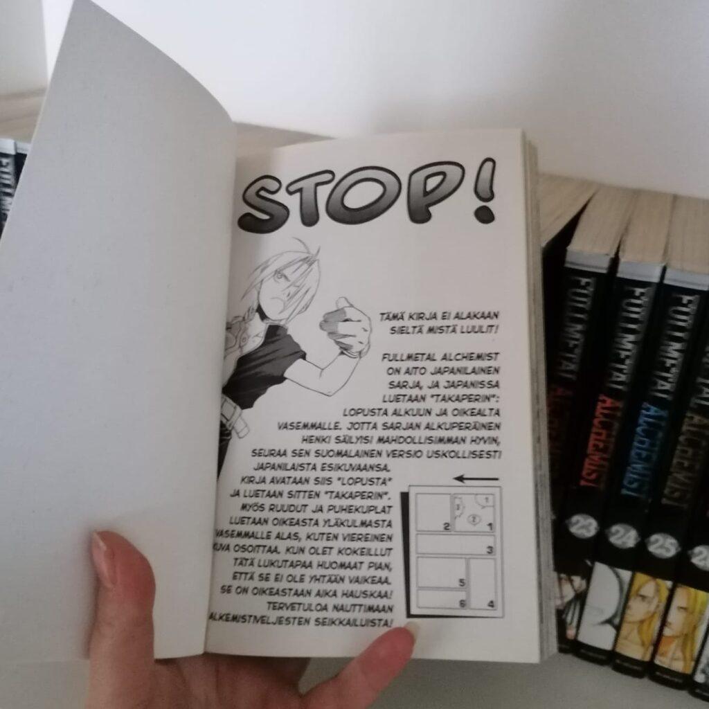 """Kuvassa on aukaistu manga, jonka viimeinen sivu on näkyvillä. Viimeisellä sivulla on isolla teksti: """"STOP!"""""""